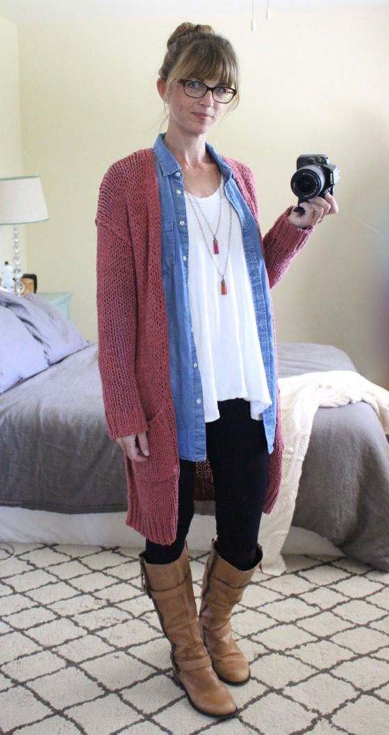 Woman Wearing - free people long cardigan, chambray tunic, white tee, black leggings, camel boots, tassel necklaces