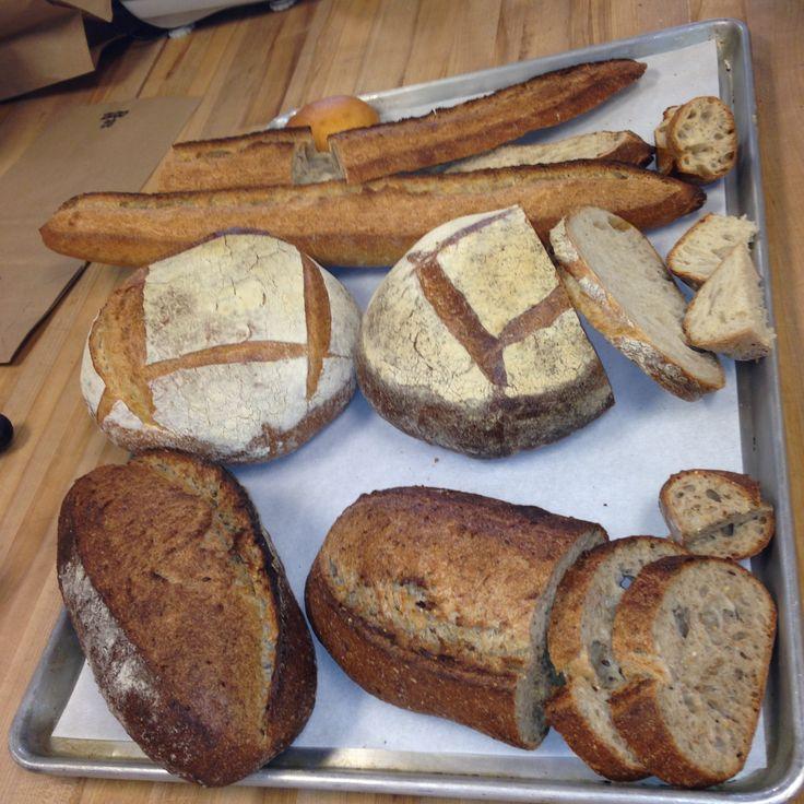 Final breads Baguette, sourdough, and multigrain loaves