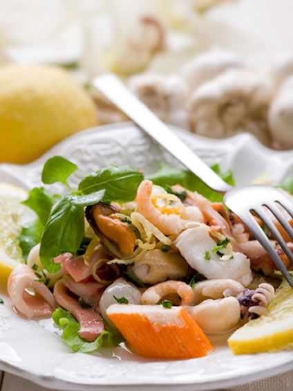This delicious recipe is really easy to make. All you need is a pound bag of mixed seafood, some garnishes, and the makings of a tasty dressing. The seafood can be raw or cooked, and you can get various types of seafood. Shrimp, scallops and mussels is a popular mix, or you might get clams, imitation fish sticks, or conch.