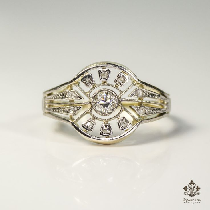Period: Art deco (1920-1935) Composition: 18K gold and Platinum. Stones: - 1 Old mine cut diamond of H-SI2 quality that weighs 0.15ctw. - 10 Rose cut diamonds of J-SI1 quality that weigh 0.10ctw. Ring