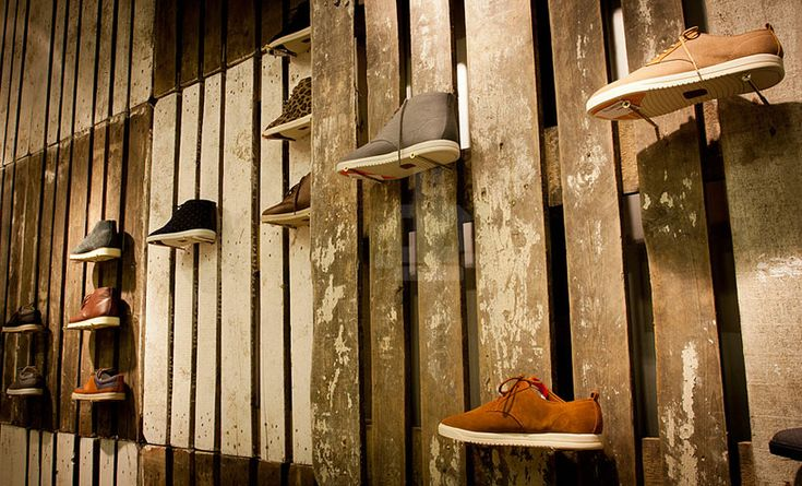 mode:lina architekci designs temporary store for 'clae footwear' - merchandise is supported by long screws, extending from the pallet walls.