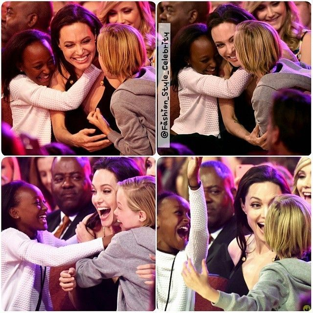 #AngelinaJolie gets big #hugs from her #kids Zahara and Shiloh Nouvel after being announced as a #winner at the 2015 Kids Choice Awards.#bradpitt #kidschoiceawards #fashion #style#celebritylook #fashionista #fashionicon #black #allblack #gorgeous #omg #love #family #icon #lbd #blackdress #hollywood #Hollywoodstar #star... - Celebrity Fashion