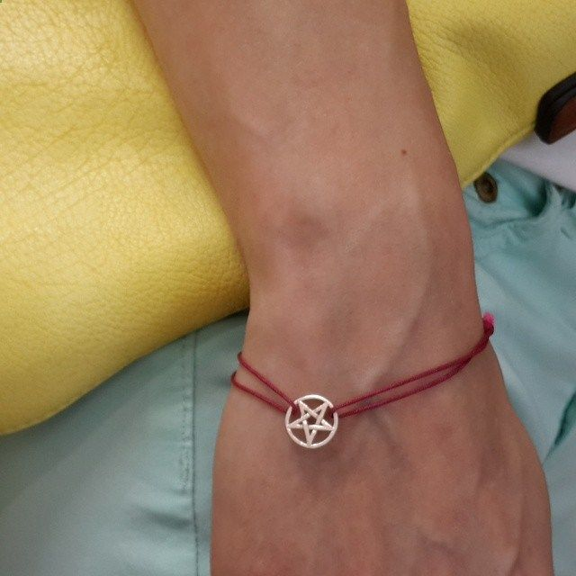 Pentagram is known as an amulet protecting against evil. In India today, they hang a star  with one beam down at the entrance to the house as home protection.For Christians, the pentagram is the five wounds of Christ, from the crown of thorns on his forehead, to the nails in the hands and feet.