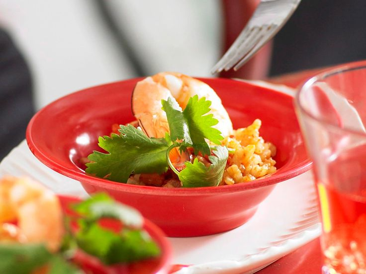 Serving this traditional, flavoursome spanish rice dish in small bowls topped with prawns, makes it versatile for any occasion and time of year.