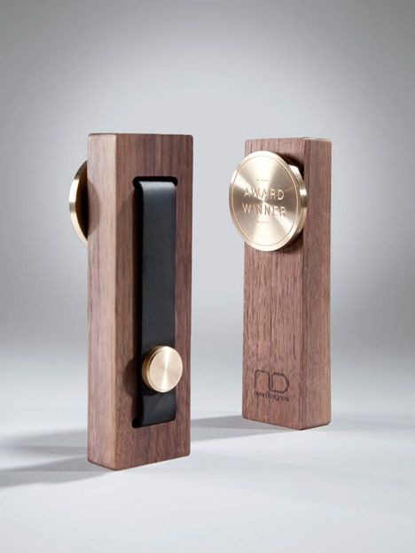 Neil Conley - New Designers Award; it's a medal stored on a wooden display stand.  Meant to evoke an Olympic medal given the Games in London this year.