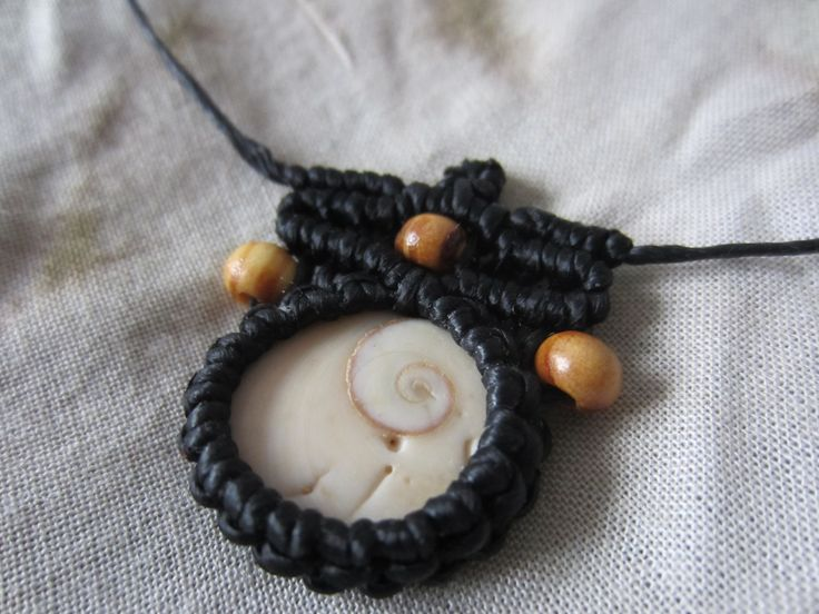 Shiva eye wrapped in black Macrame with wodden pearls. Adjustable in length.  Created with love.  *All products are ready for shipping*