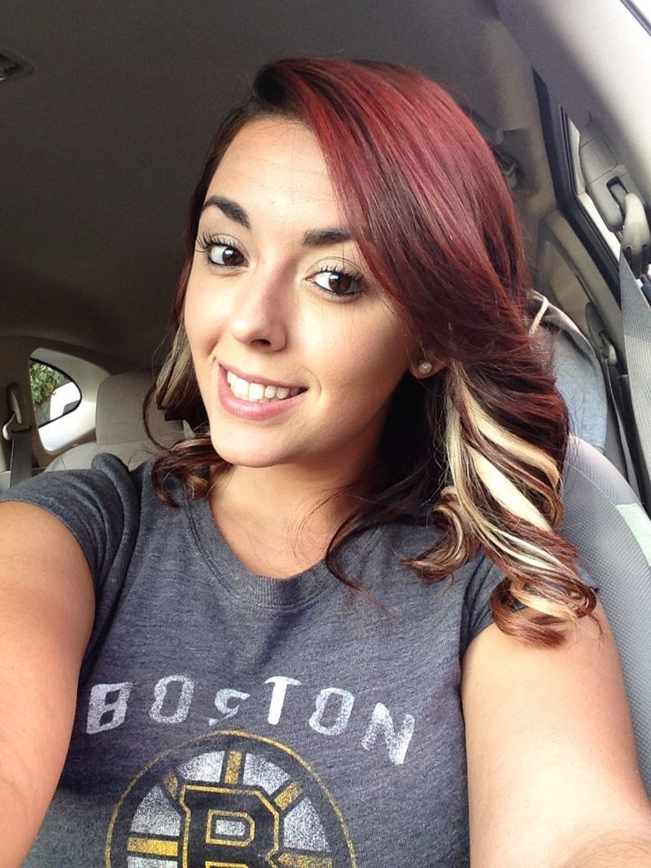 Burgundy red hair with blonde peekaboo highlights , this is what it looks like when it fades