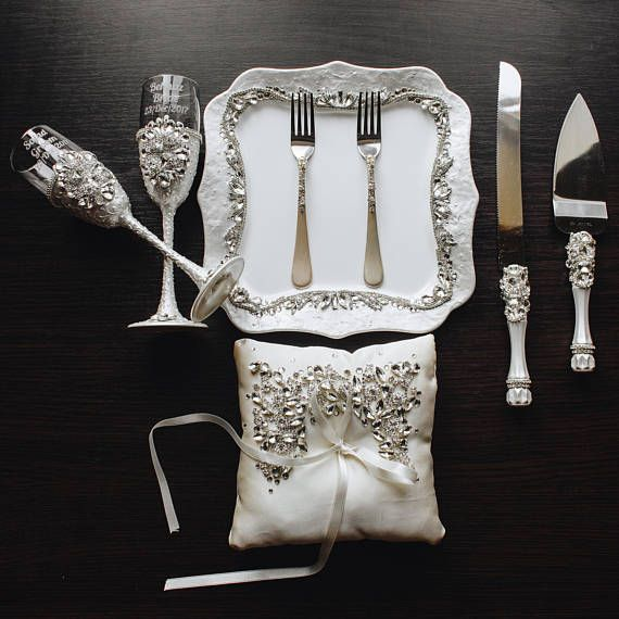 wedding glasses and cake server set plate and forks wedding bearer pillow Champagne glasses cake cutter set white and silver Wedding set of8 For these glasses color: pearl white color and silver crystals All completely handmade! MEASUREMENTS: -Champagne flutes : Height - 9 inch (22