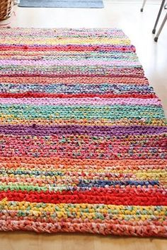 Handmade Crochet Rug - made out of thrift store sheets: white, pastel, & floral. I like the rectangular shape over ovals/circles. Stitch several together for a larger rug. Super inexpensive!