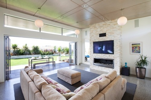 modern. clean. LOVe the fireplace. so excited to see plush-comfy sectional in a modern room-brilliant. H-E-L-L-O fold out doors.
