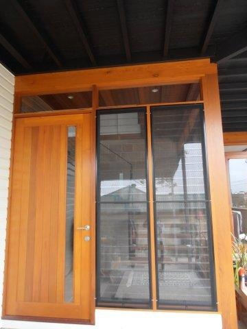 House Entry door.  This 3m high timber front door and glass louvres make a grand entry to this beautiful renovated Queenslander. www.empiredesigns.com.au