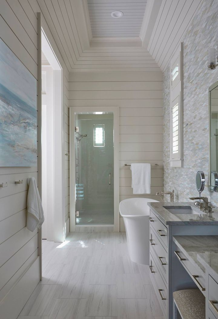 coastal bathroom with freestanding soaking tub