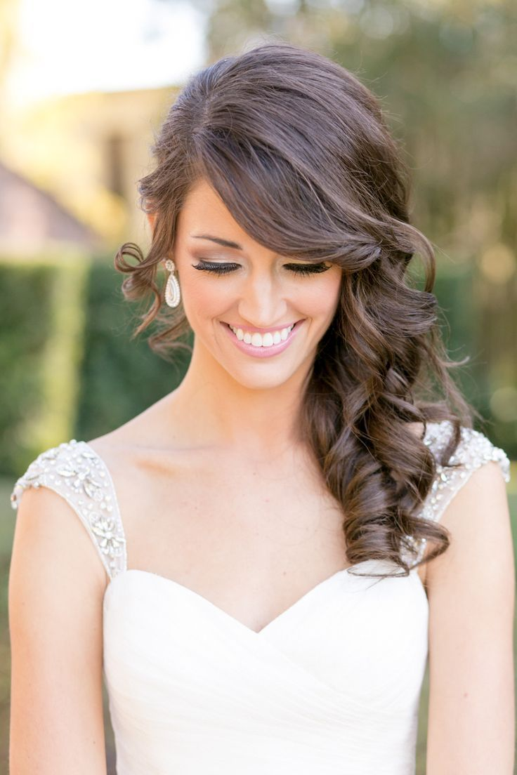Curly side swept hairstyle for the bride
