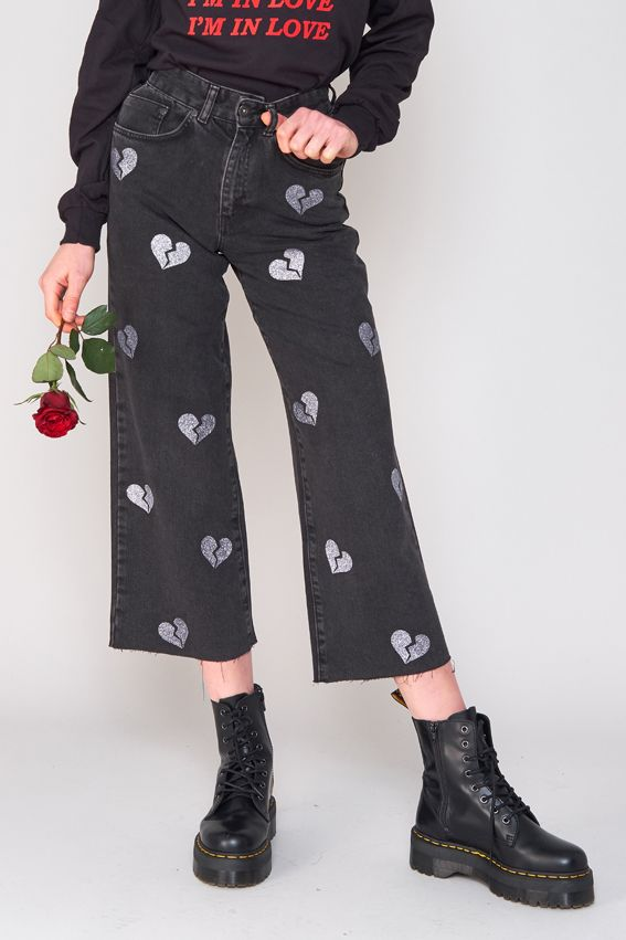 "Wear your heart in your jeans. High waisted, wide leg skater fit. Flattering butts worldwide. This cut is 100% cotton with no stretch, please refer to our size guide for full details. – Valentines capsule Collection – Skater Jean fit – 100% Cotton – Sizes 24″,26″,28″,30″,32″, 34″ – Model is 5ft 9"" and wears size 26″"