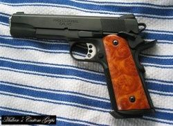 Kimber Custom II with after-market mag well and grips