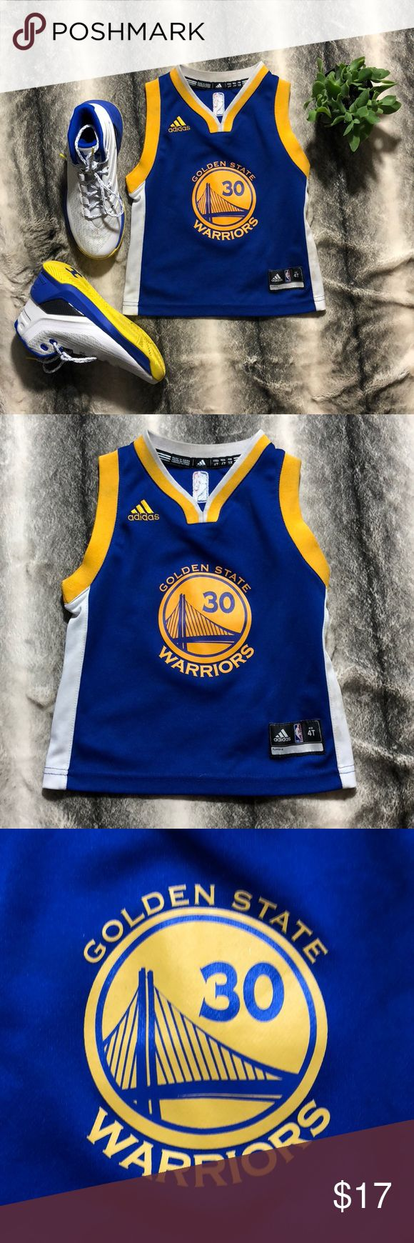 Golden State Warriors Jersey This is a fair condition Golden State Warriors Jersey for a 4T. The Jersey has some dirt stains on the white side and necks with a mild stain on the back bottom (as shown in the photos) i have not dry cleaner the Jersey but I am sure you can find a way to make this Jersey pearly white. Make me an offer. adidas Shirts & Tops