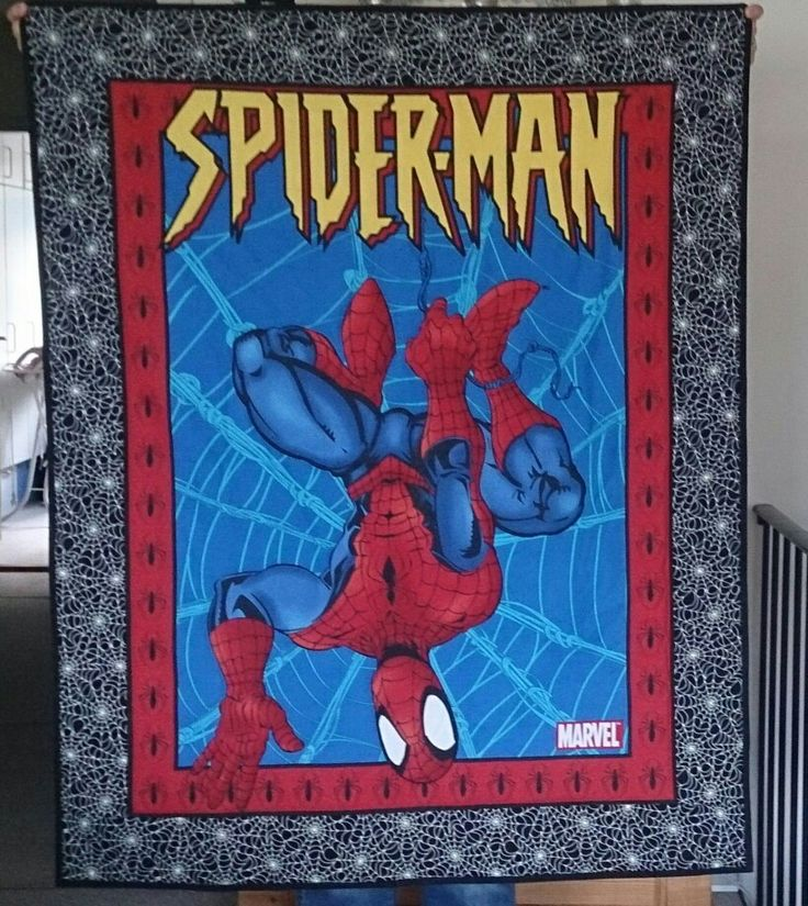 Forside af tæppe med Spiderman