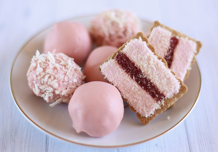 An Iced VoVo is an iconic Australian biscuit consisting of a wheat biscuit topped with pink marshmallow on either side of a strip of raspberry jam and sprinkled with coconut.  #IcedVoVo
