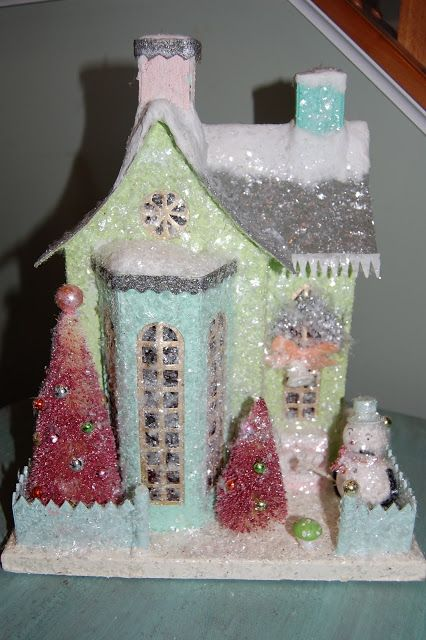 from the blog Natalie Loves...: Do-it-yourself glittered Christmas. I remember these wonderful little Christmas houses from my childhood and I plan to keep my eyes open for them in antique shops and flea markets but this blog has a wonderful how-to pictorial about making your own...How fun!
