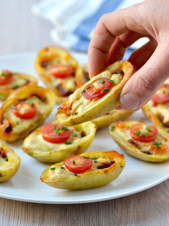 http://www.coconutandberries.com/2015/05/15/mini-vegan-pizza-potato-skins/ Produce      1 Cherry tomatoes     1 Chives     1 Potatoes, New  Condiments      1 Sun-dried tomato paste  Baking & Spices      1 Salt  Oils & Vinegars      1 Olive oil  Dairy      1 Tahini cheese #fast, easy, affordable, cheap, vegetarian, vegan, meal, gluten-free, make substitutions   delicious