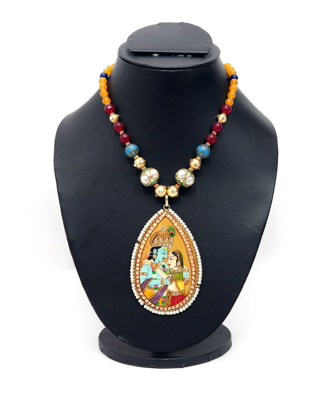An exquisite Radha Krishan pendant (Gold Plated) Tanjore Work. Handcrafted with India's leading craftsman from Jaipur, Rajasthan.  Each semi precious stone is adorned with Kundan work.  ( Since each piece is delicately handcrafted, there might be a slight colour variation).
