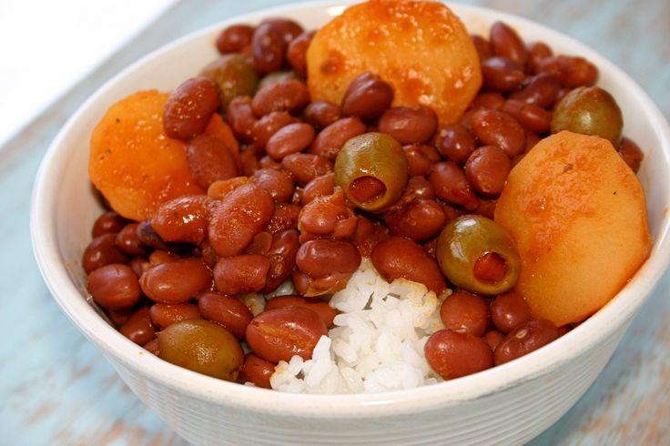 Flavorful Puerto Rican rice & beans simmered in a sauce of sofrito and tomato along with potatoes and olives. Classic Puerto Rican recipe!