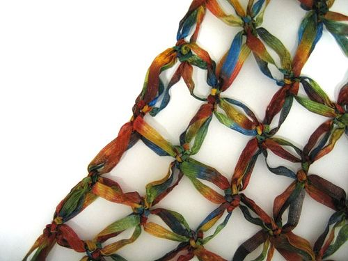 Solomon's Knot Shawl  very nice video tutorial:  http://www.youtube.com/watch?v=zuItYejJrfg  It all makes sense now!  I have some wonderful ribbon yarn.  \o/ ** link doesn't work, have to copy and paste YouTube address..