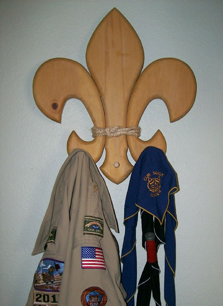 Large Wooden Fluer-de-lis wall décor with pegs. $40.00, via Etsy.  How we keep our scout shirts and neckerchiefs in one place.