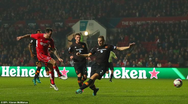 Substitute Lee Tomlin set up a dramatic finale when he fired home for the home side in stoppage time