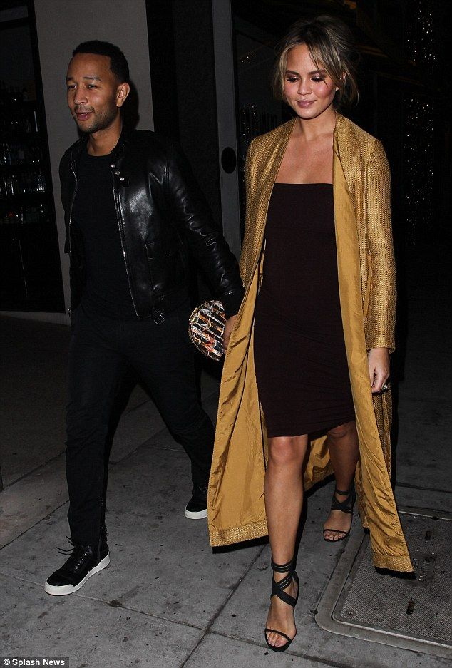 Glimmering goddess! Chrissy Teigen, 30, and John Legend, 36, stepped out for a romantic di...