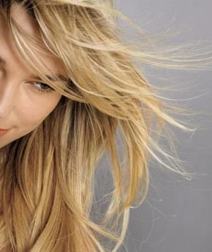 Blonde hair blowing | Get out the door on time: How to dry straight or curly hair faster―and better.