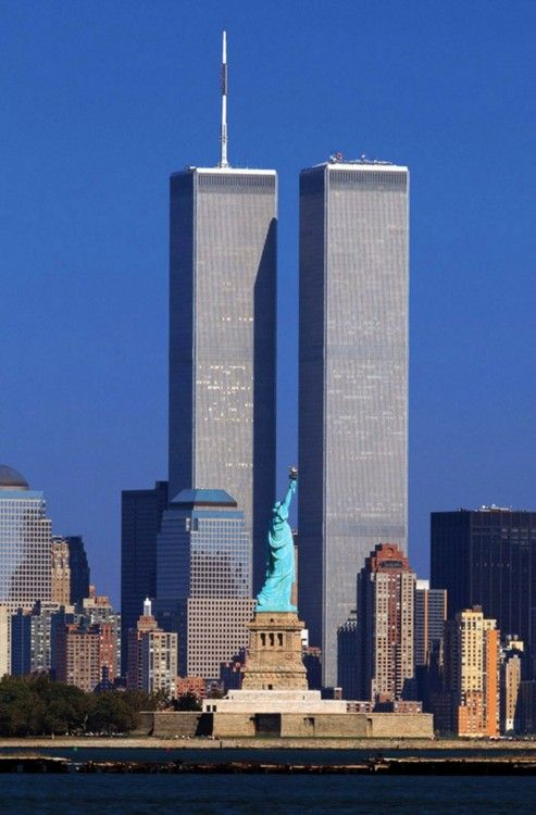 The Twin Towers with the Statue of Liberty in foreground. Gone forever but forever in our hearts.