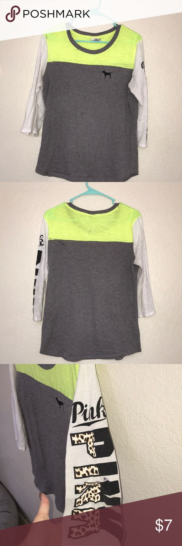 Victoria's Secret quarter sleeve shirt Quarter sleeve shirt with neon yellow at top and cheetah print writing on sleeve. Slightly worn | selling cheap due to some ink stains PINK Victoria's Secret Tops Tees - Long Sleeve