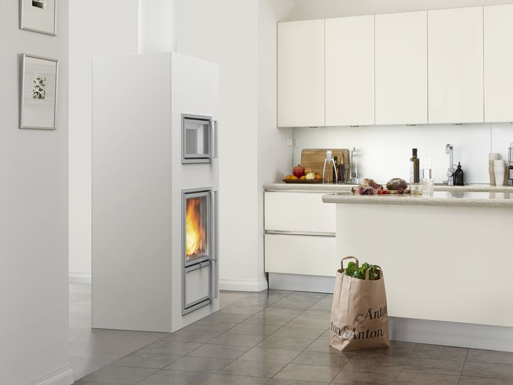 Mustio heat-retaining fireplace with a stew bakeoven.