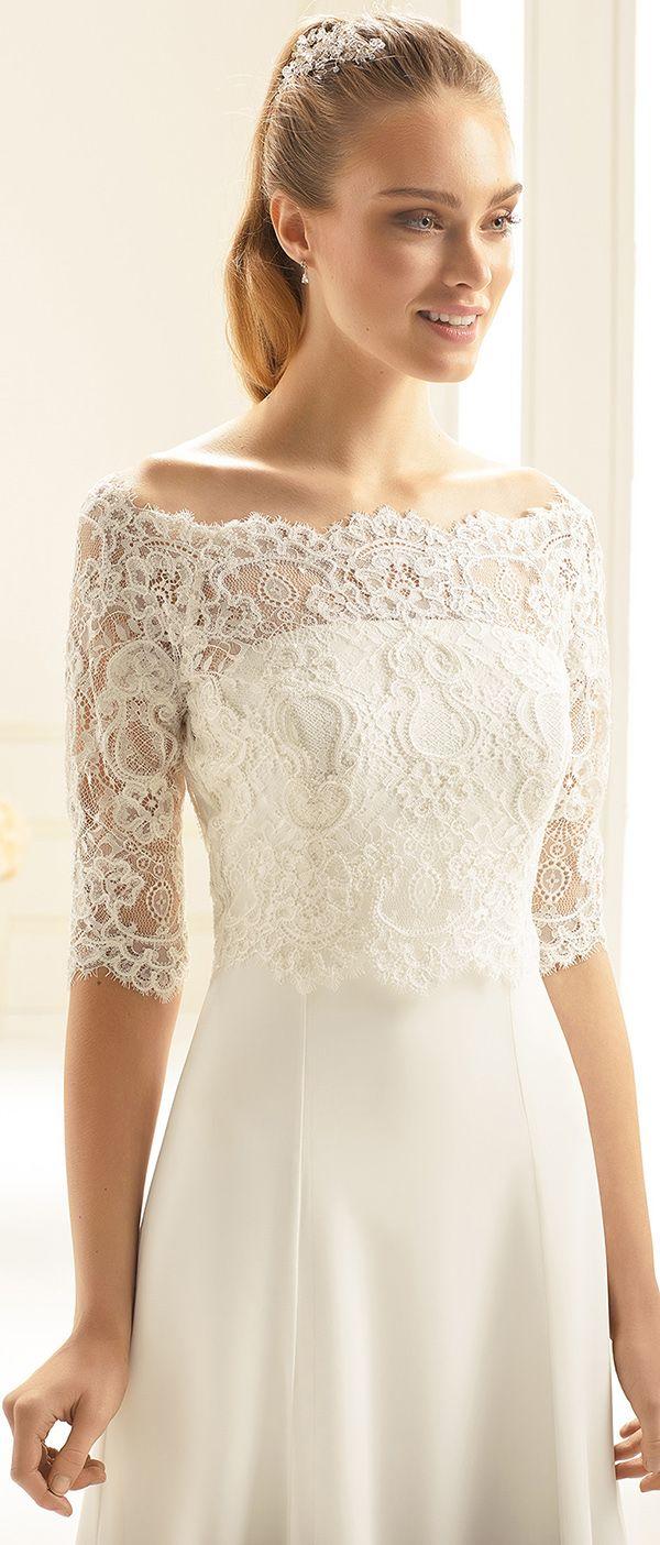 Our bolero E255 made for a winter bride! See more at bianco-evento.com #biancoevento #wedding #weddingdress #bridalwear #bridaccesorries #winterwedding #weddingideas