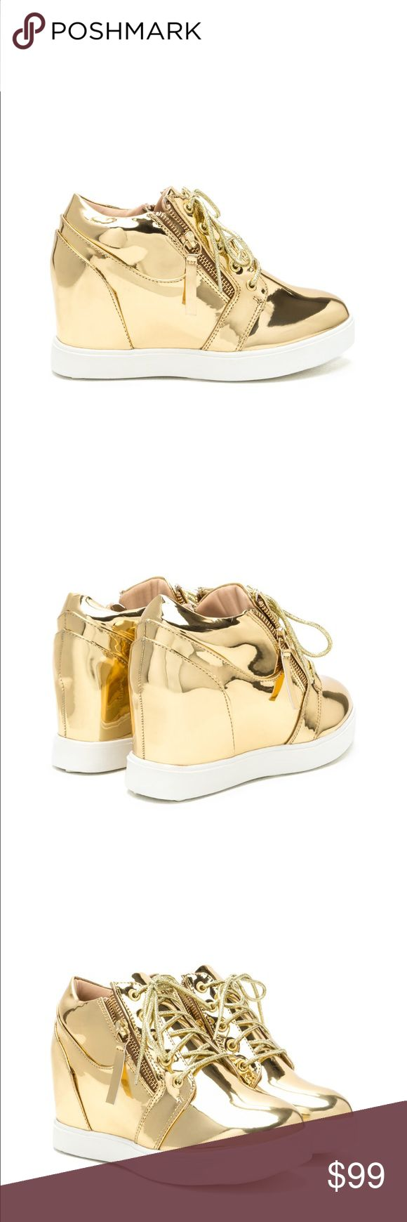 Metallic gold wedge sneaker Metallic gold wedge sneaker. Vegan patent leather wedge. 3 in wedge heel. New in box never worn. Ships within 7 business days. boutique Shoes Sneakers