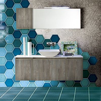 Shades of blue and green hexagon tiles covering only part of the wall creates great visual interest!