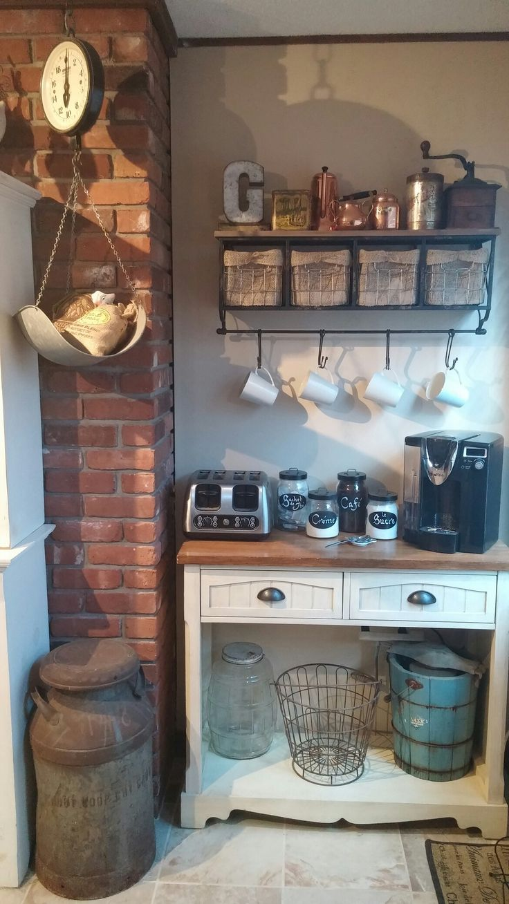 Coffee bar done. Hobby lobby for shelf and the letter then added my own burlap to the baskets to hide k cups, the rest are antique or vintage kitchen items. Market hanging scale, milk can, wire basket. Rustic french country farmhouse kitchen.