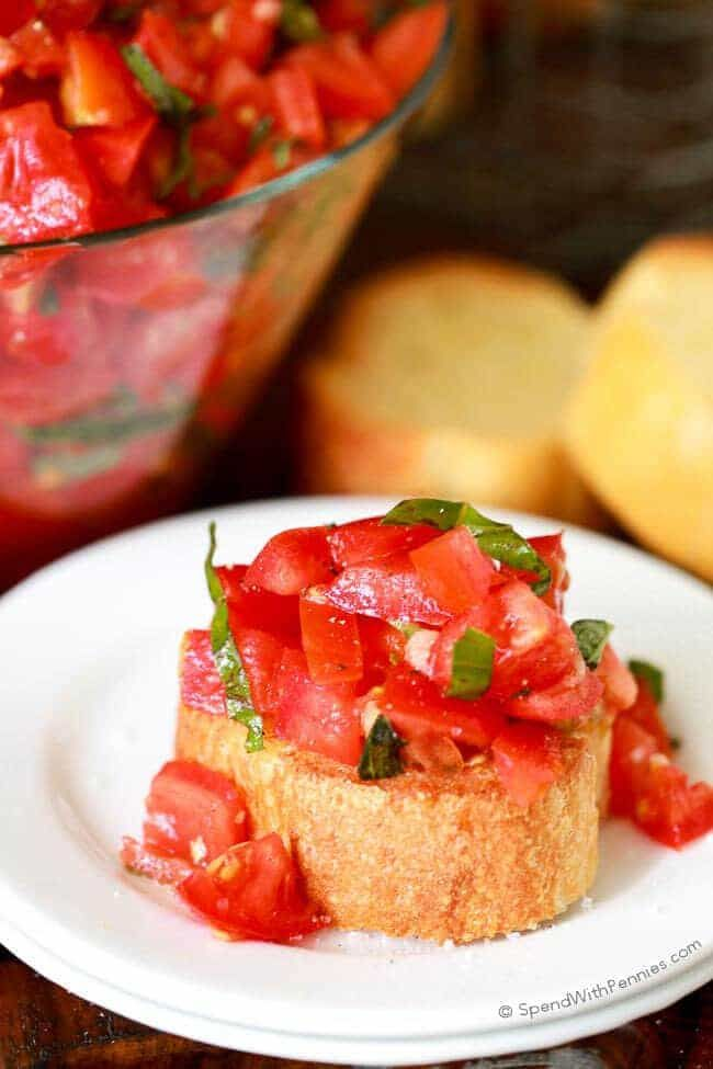 Garlic toast topped with juicy tomatoes, basil, salt and pepper.  This tomato bruschetta is one of our all time favorite appetizers! #spendwithpennies #appetizer #tomatoes #bruschetta #fresh