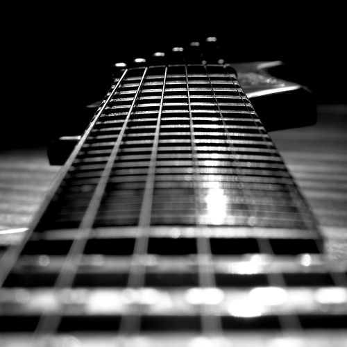 by Robert Valencia; guitar strings - photography of music