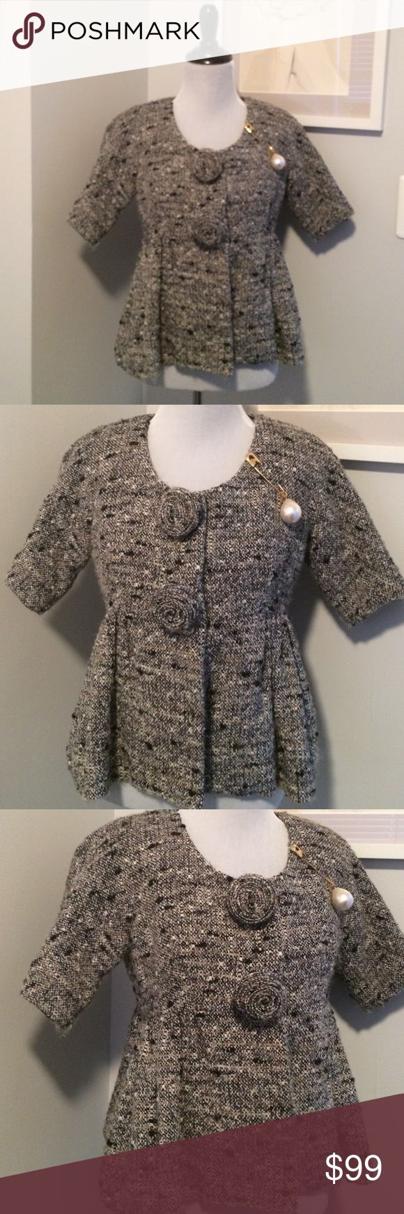 📌FINAL Adorable Vintage Tweed Anna Sui Jacket (Brooch not included) An adorable vintage tweed jacket by designer Anna Sui at her peak. Two sweet tweed roses where the jacket snaps are. The only flaw is deodorant marks inside the lining. I am pretty certain a good cleaner could get those out. Re-listed for photos. Anna Sui Jackets & Coats