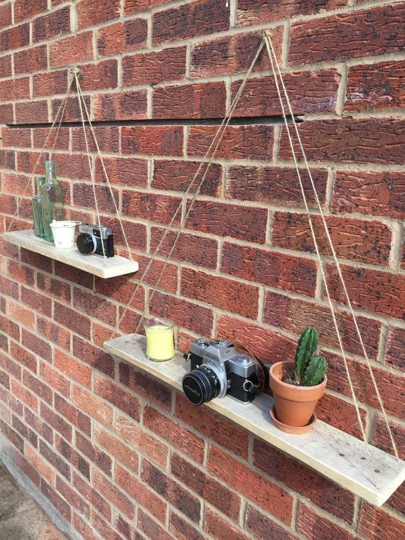 Reclaimed pallet wood hanging shelves by SunnySideInteriors