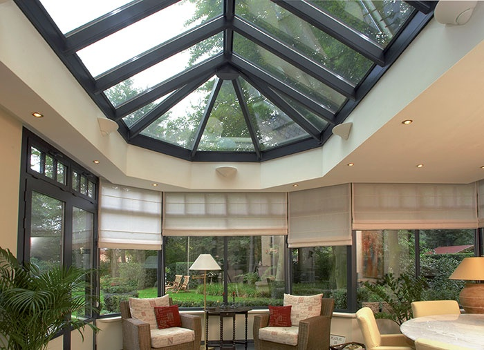 Escape the busy world and relax in this aluminium conservatory