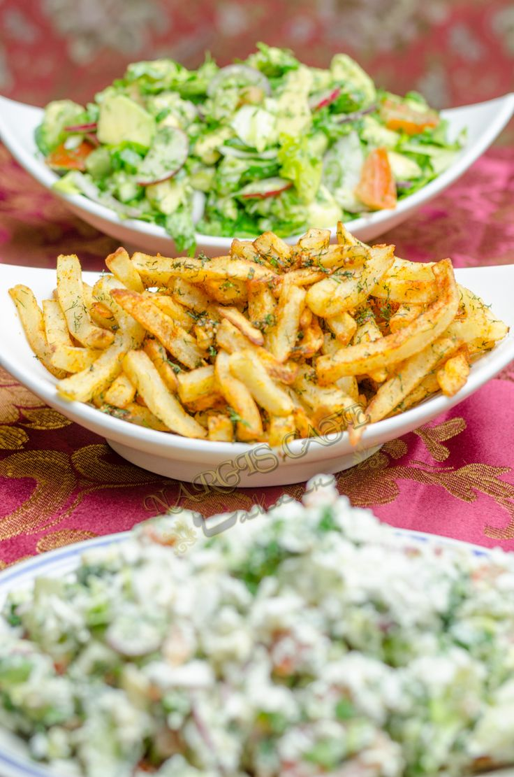 "A perfect trio of side dishes.  1 - ""Navruz"" salad (Cucumber, radish, boiled eggs, tomatoes, topped with feta cheese). 2 - French fries with garlic and herbs. 3 - Cucumber, scallions, radish and herb salad with suzma and sour yogurt dressing.  www.nargiscafe.com  #nargis #salads #frenchfries"
