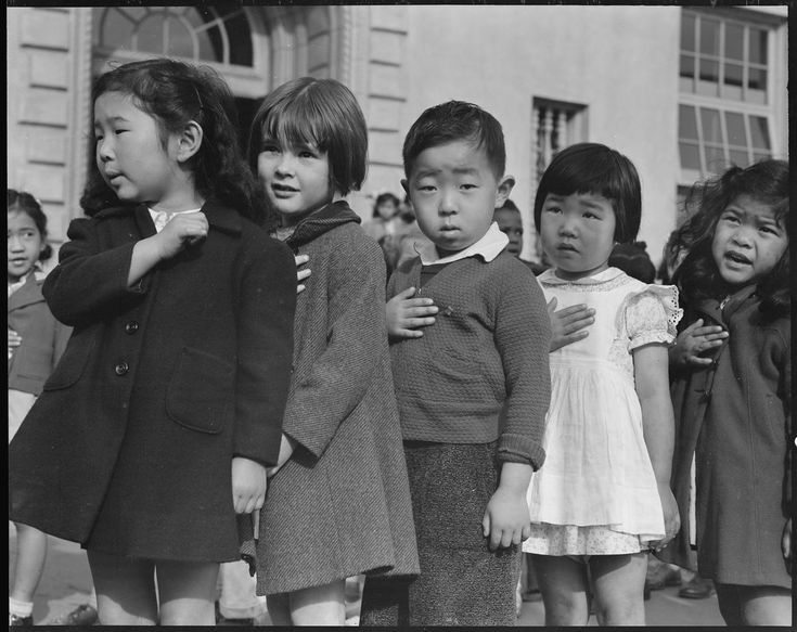 San Francisco, California. Many children of Japanese ancestry attended Raphael Weill public School, Geary and Buchanan Streets, prior to evacuation. This scene shows first- graders during flag pledge ceremony. Evacuees of Japanese ancestry will be housed in War Relocation Authority centers for the duration. Provision will be effected for the continuance of education.