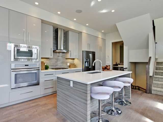 Love the height of the cabinets and the two tone finish