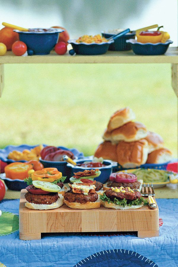 Entertain guests with this impressive yet easy backyard burger menu. From serving refreshing homemade soda and juicy burgers to finishing with decadent banana pudding, you'll be known as the block party queen or king.  Get the Recipes:  Barbecue Bean Dip Homemade Orange Soda Barbara's Big Juicy Burgers Potato Cobb Salad Marinated Green Tomatoes Grilled Red Onions Five-Bean Bake Over-the-Moon Banana Pudding