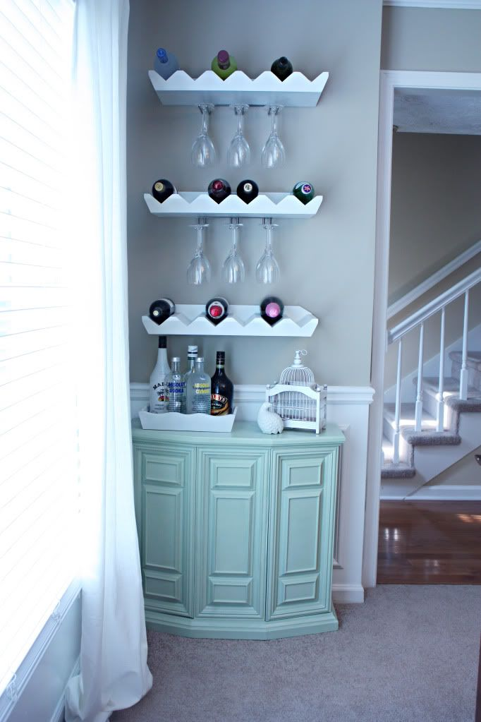 I think I'm going to do this in our dinning room on the wall, only with one or two shelves and no cabinet. It'll get my wine glass out of much needed cabinets and allow me to store wine.