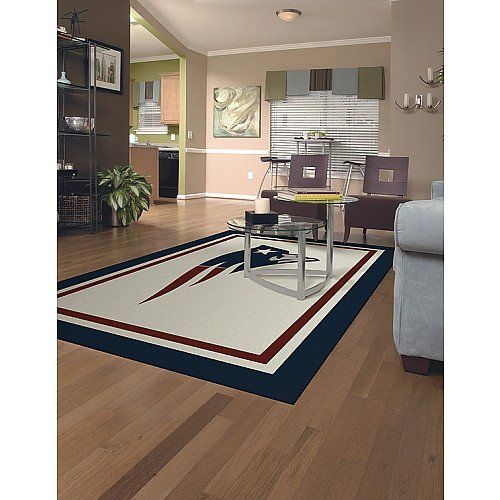 Miliken & Company New England Patriots 10-Ft. 9-In. x 13-Ft. 2-In. Spirit Area Rug Miliken and Company http://www.amazon.com/dp/B000XH5GUO/ref=cm_sw_r_pi_dp_nVe1tb0YNCF5BJ95