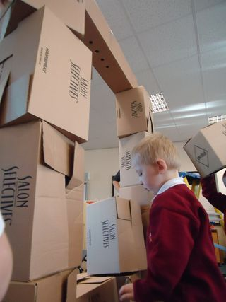 "Alistair spots the boys building with boxes ("",)"